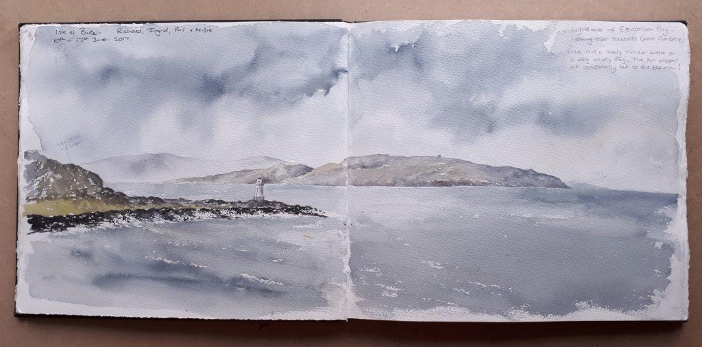 Watercolour seascape painted across a sketchbook spread